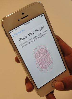 A new iPhone 5S handset, which lets the user unlock the phone with a fingerprint, pictured September 10, 2013