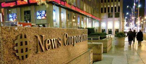 A News Corp. sign is seen outside of its offices in New York, October 27, 2004