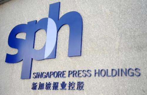 A new Singapore Press Holdings (SPH) logo is unveiled at a ceremony marking the company's 25th anniversary in Singapore on March