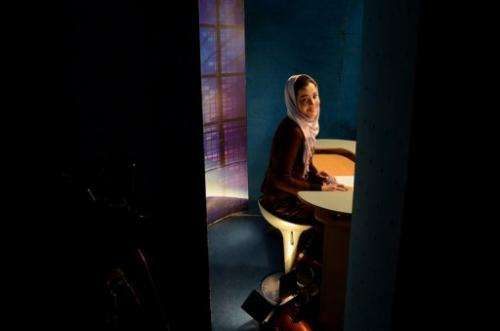 A news presenter prepares to read the news at a studio in Kabul on January 30, 2013