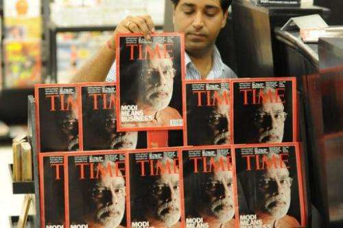 An Indian salesman arranges copies of Time magazine in Ahmedabad on March 18, 2012