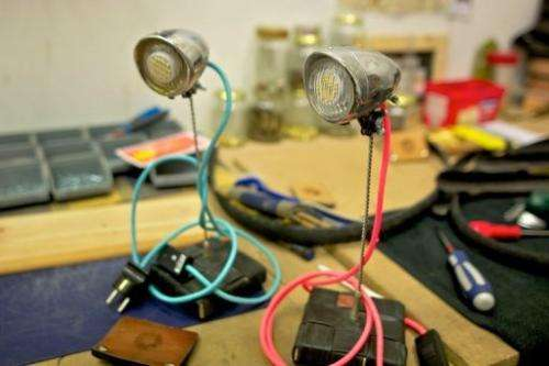 A pair of lamps made with bicycle parts are on show at the workshop of Upcycle on May 17, 2013 in Delft