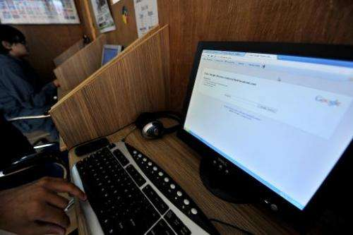 A Pakistani computer user at an internet cafe in Islamabad on May 19, 2010