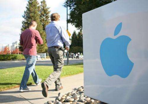 Apple employees walk towards the Apple Headquarters in Cupertino, California, on October 19, 2011