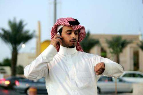 A Saudi man talks on his mobile phone in Riyadh on March 2, 2006