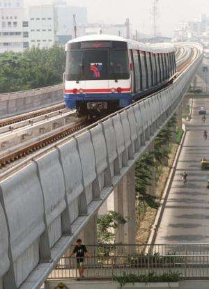 A skytrain, part of Bangkok's first mass transit system, makes its way above city street on October 27, 1998