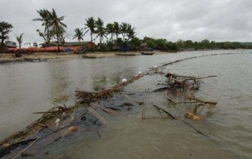 A stretch of oil spill boom made of improvised materials is seen on central Guimaras island, on September 4, 2006