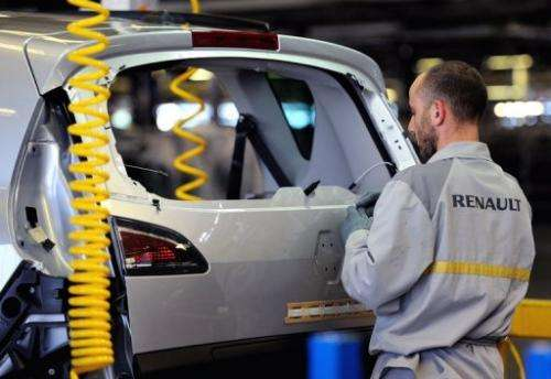 A technician at a Renault plant in the northern city of Douai, works in an assembly line on May 23, 2013