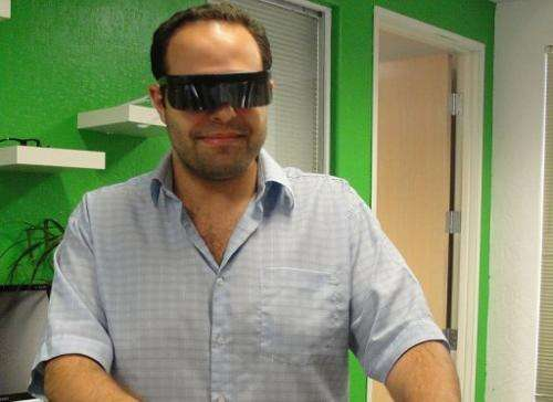 Atheer co-founder Soulaiman Itani poses with the prototype glasses that overlay the Internet on the real world in 3D