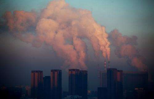 A thermal power plant discharges heavy smog into the air in Changchun, China, on January 22, 2013