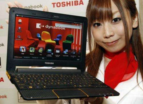 A Toshiba employee unveils a Dynabook AZ laptop at a Tokyo hotel on June 21, 2010