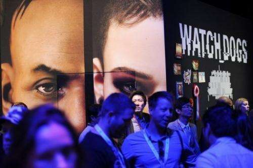 "Attendees stand at the ""Watch Dogs"" display at the E3 gaming industry conference in Los Angeles June 12, 2013"