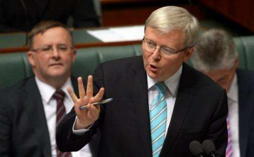 Australian Prime Minister Kevin Rudd (C), pictured in Canberra, on June 27, 2013