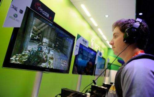 A visitor tries out the Microsoft Xbox 360 at the 2012 International Consumer Electronics Show in Las Vegas