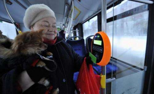 A woman and her dog make the most of free travel on a bus in Tallinn, on January 9, 2013