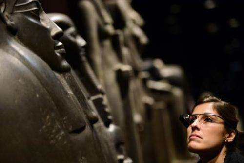 A woman tests a pair of Google glasses equiped with Italian Sign Language capabilities at the Egyptian Museum in Turin, on Novem