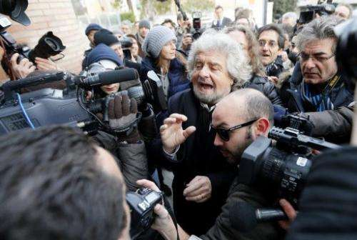 Beppe Grillo is surrounded by journalists, on January 25, 2013, in Siena