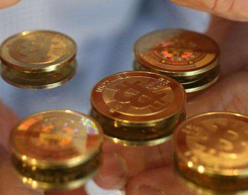 Bitcoin's minted to reveal a code are displayed in a shop on April 26, 2013 in Sandy, Utah