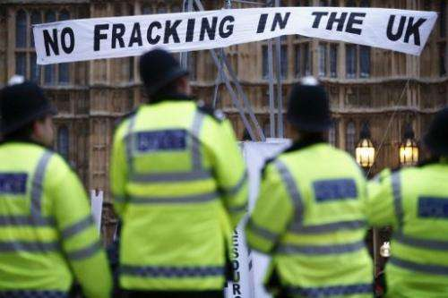 British police watch an anti-shale gas and fracking protest outside parliament in London