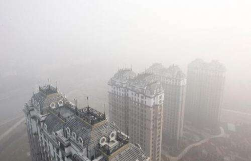 Buildings and streets are seen shrouded in heavy smog in Harbin, China's Heilongjiang province, on October 22, 2013