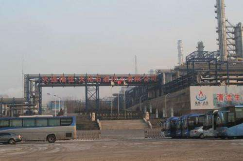 Buses stop outside the Dalian Fujia Dahua Petrochemical factory in Dalian, China on January 18, 2013