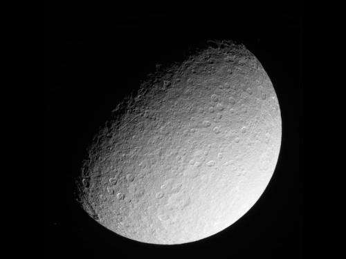 Cassini returns images of battered Saturn Moon