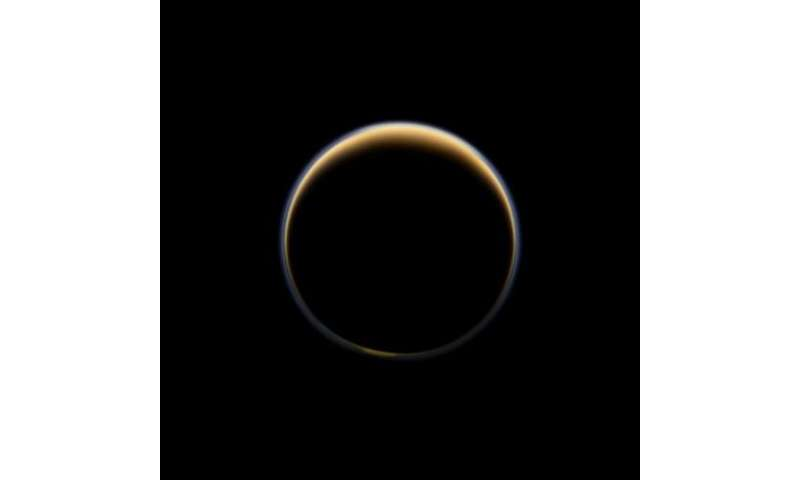 Cassini sees precursors to aerosol haze on Titan