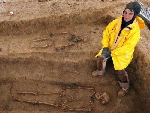 Cecile Paresys stands next to the bones of two Gauls,  on a site in Bucheres, near Troyes, on April 11, 2013