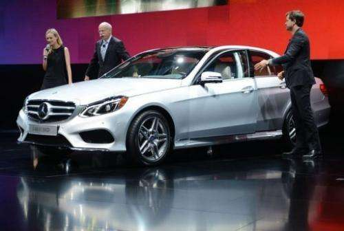 Chairman of Mercedes-Benz Cars (C) introduces the E-400 Hybrid at the Detroit auto show in Michigan on January 14, 2013