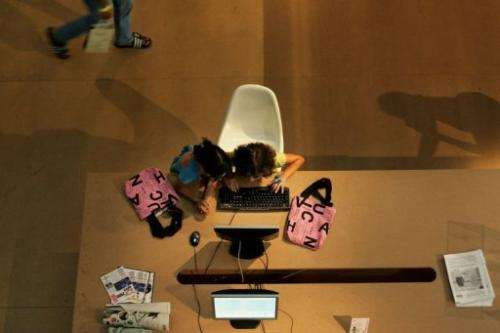 Children use the Internet at the 20th Sao Paulo Fashion Week, in Sao Paulo, Brazil on January 20, 2006