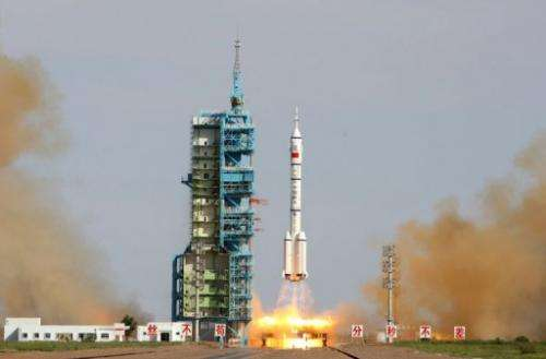 China's Shenzhou-10 rocket blasts off from the Jiuquan space centre in the Gobi Desert, on June 11, 2013