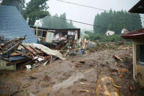 Collapsed houses are seen following floods near Lake Tazawa, in Semboku, Akita prefecture in Japan, on August 10, 2013