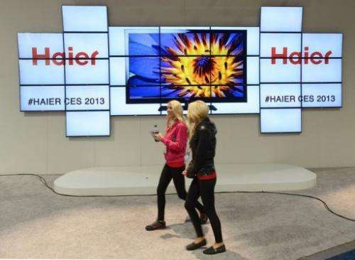 Consumers walk by the Haier booth at CES on January 10, 2013 in Las Vegas, Nevada