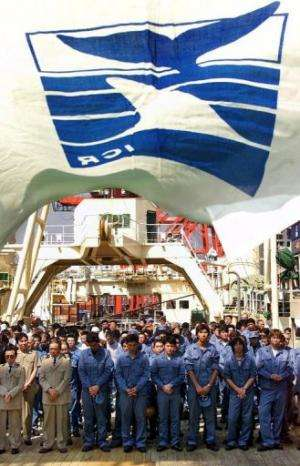 Crew of Japan's whale research vessels at a returning ceremony at Tokyo port on September 21, 2000