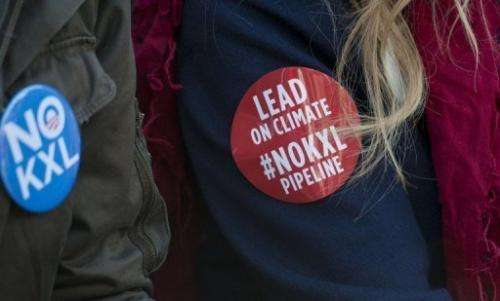 Daryl Hannah wears a sticker as she protests against Keystone XL Pipeline on February 13, 2013 in Washington, DC