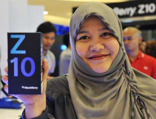 Diana Monasapti shows the Blackberry Z10 she bought at its launch in Jakarta on March 15, 2013