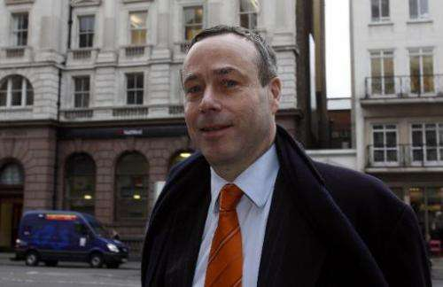 Editor of the Financial Times newspaper Lionel Barber arrives at the High Court in London on January 10, 2012