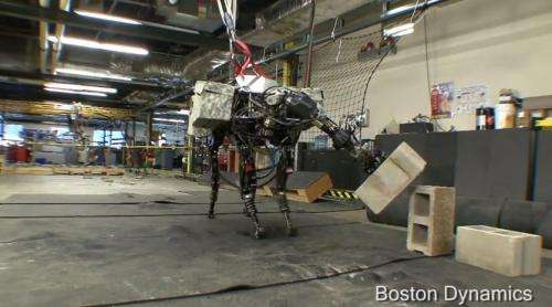 Now Boston Dynamics' BigDog can lift and toss  (w/ video)