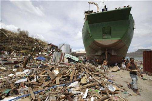 Experts: Man, nature share typhoon tragedy blame