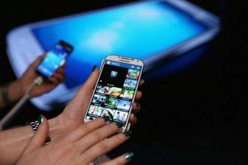 Fans get hands on with the Samsung Galaxy S4 on April 25, 2013 in New York City