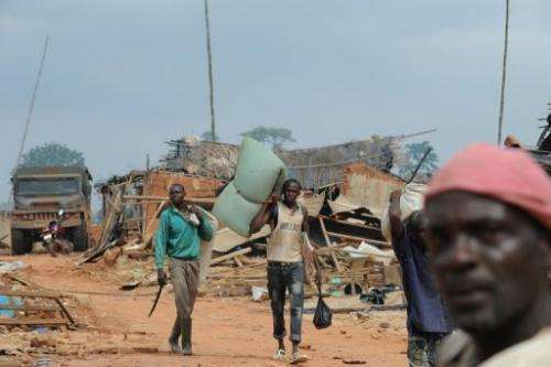Farmers leave Baleko-Niegre village in southwestern Ivory Coast, on June 22, 2013