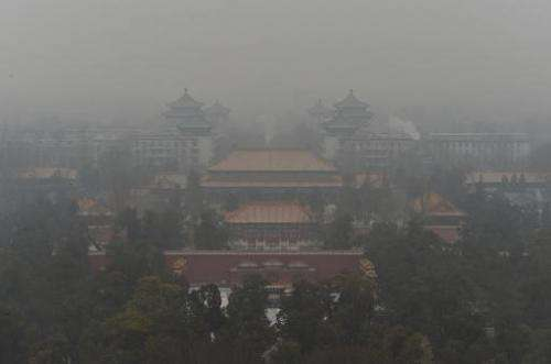 File photo of Beijing's famous Guotai Chambers in Jingshan Park covered in smog