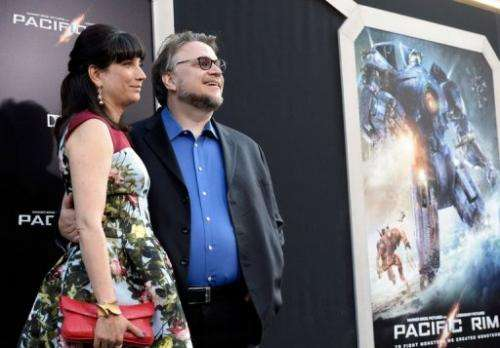 Filmmaker Guillermo del Toro (R) and his spouse Lorenza Newton, pictured in Hollywood, on July 9, 2013