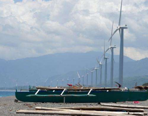 Fishing boats anchored next to wind turbines on Bangui Bay in Ilocos norte, north of Manila, on May 4, 2013