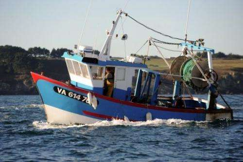 French fishermen leave the port of Quiberon, western France on October 30, 2012