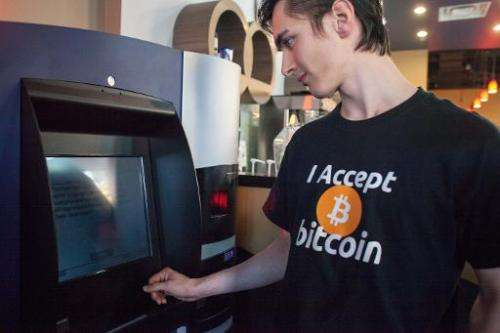 Gabriel Scheare uses the world's first bitcoin ATM on October 29, 2013 at Waves Coffee House in Vancouver
