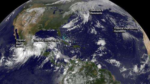 GOES Satellite catches 3 tropical cyclones in 1 shot, sees Gabrielle absorbed