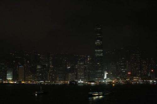 Hong Kong's Victoria Harbour waterfront is seen with its lights dimmed during Earth Hour on March 31, 2012