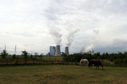 Horses graze in front of the new Neurath lignit coal-fired RWE power station on September 11, 2012 at Grevenbroich