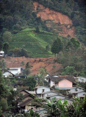 Houses in Dewata village, West Java lie buried under earth after a landslide in February 24, 2010